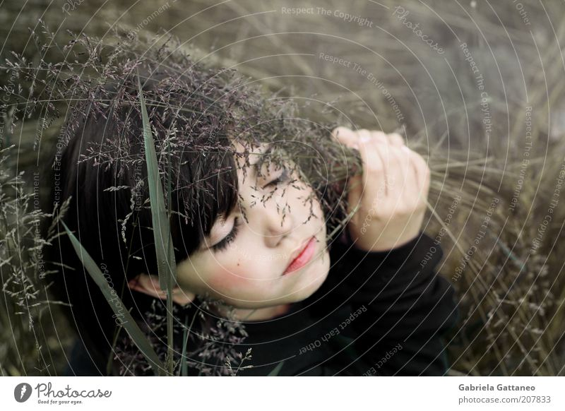 Human being Nature Face Calm Eyes Dark Autumn Feminine Emotions Grass Dream Moody Brown Sleep Safety Protection