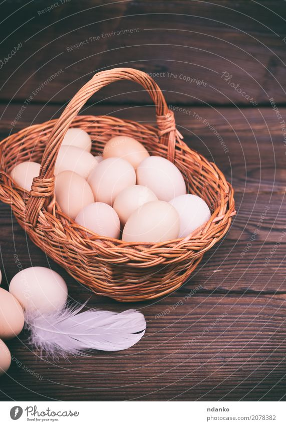 basket with raw chicken eggs Eating Breakfast Diet Table Easter Wood Fresh Natural Above Brown Tradition Chicken Organic Farm Tasty healthy Shell Fragile