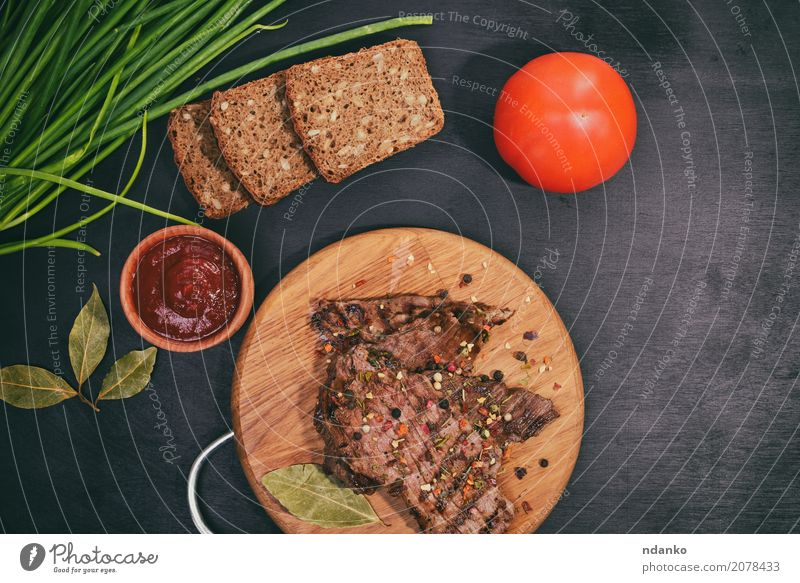 Grilled beef on a wooden board Meat Vegetable Bread Herbs and spices Nutrition Lunch Dinner Table Kitchen Wood Eating Fresh Above Green Red Black Onion Dish