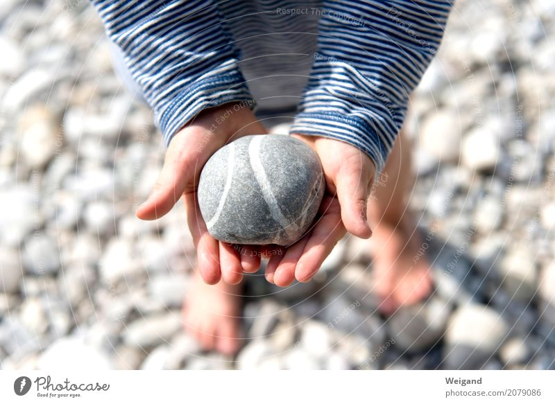 Child Vacation & Travel Hand Beach Coast Earth Gray Stone Leisure and hobbies Eternity Friendliness Round Protection Safety Stop Trust