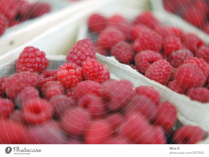 raspberries Food Fruit Nutrition Organic produce Vegetarian diet Small Delicious Juicy Sour Sweet Raspberry Berries Market stall Farmer's market Colour photo