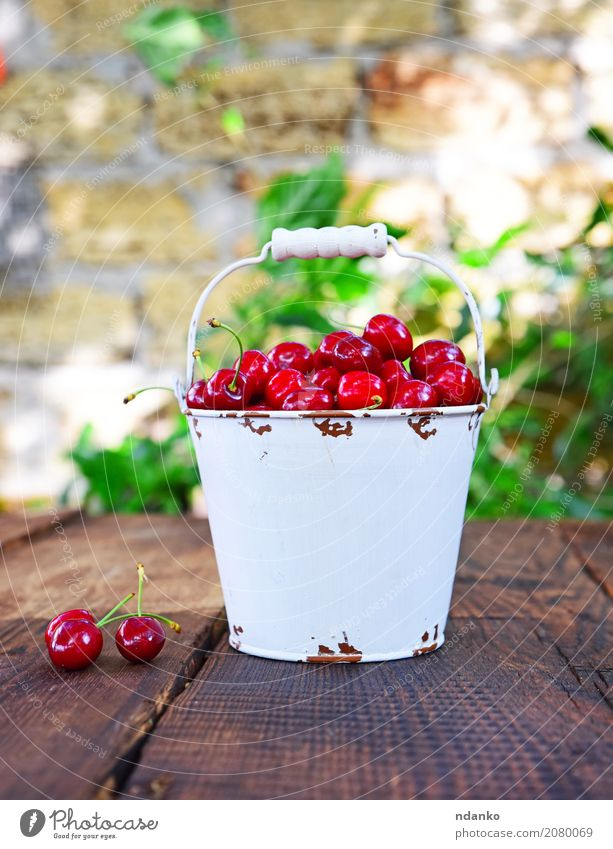 Red ripe cherry Fruit Dessert Nutrition Vegetarian diet Diet Juice Bowl Summer Garden Table Nature Wood Eating Fresh Bright Delicious Natural Juicy White many