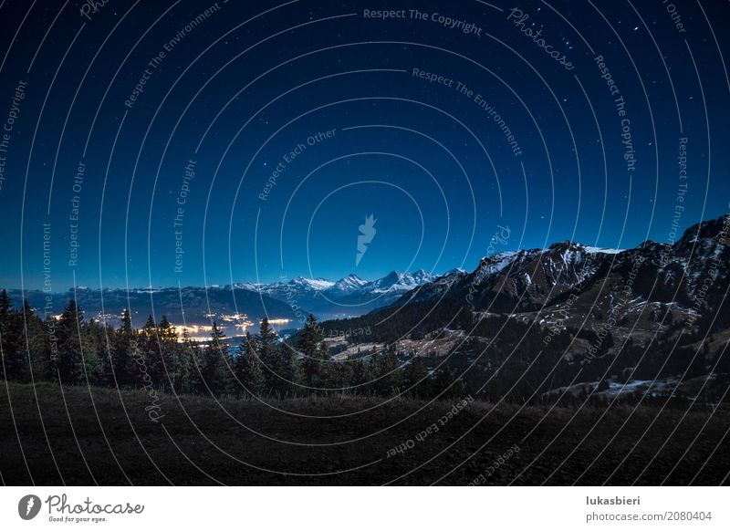 Night shot with a view of the snowy mountains and Lake Thun Environment Nature Landscape Sky Stars Autumn Winter Beautiful weather Fog Snow Snowcapped peak