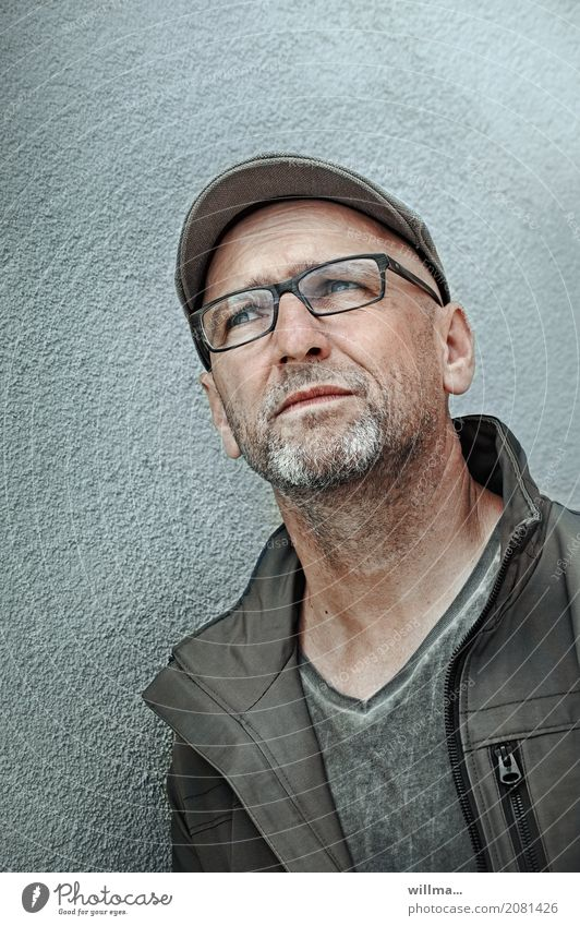 Man with glasses looks up skeptically Human being Masculine Adults Life 1 45 - 60 years Jacket Eyeglasses Hat Peaked cap flat cap Gray-haired Facial hair