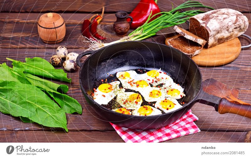Fried eggs Green Red Dish Eating Natural Wood Above Fresh Herbs and spices Kitchen Delicious Restaurant Breakfast Tradition Bread Dinner