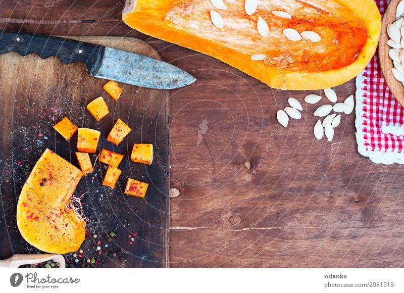 Piece of raw pumpkin Vegetable Herbs and spices Knives Wood Eating Fresh Natural Above Brown Orange pepper paprika salt knife cook seasoning Ingredients vintage