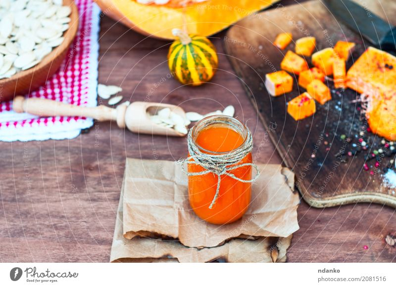 Pumpkin juice with spices Herbs and spices Juice Spoon Paper Wood Fresh Natural Above Brown White glass Useful pepper paprika orange knife cook seasoning