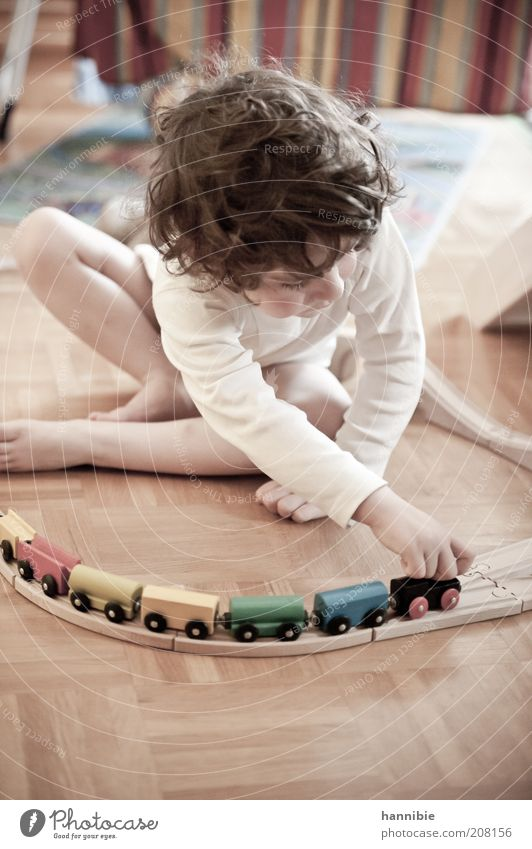 tuut tuut... Playing Model railroad Children's game Boy (child) Infancy 1 Human being 3 - 8 years wooden railway Wooden toy Curl White Parquet floor