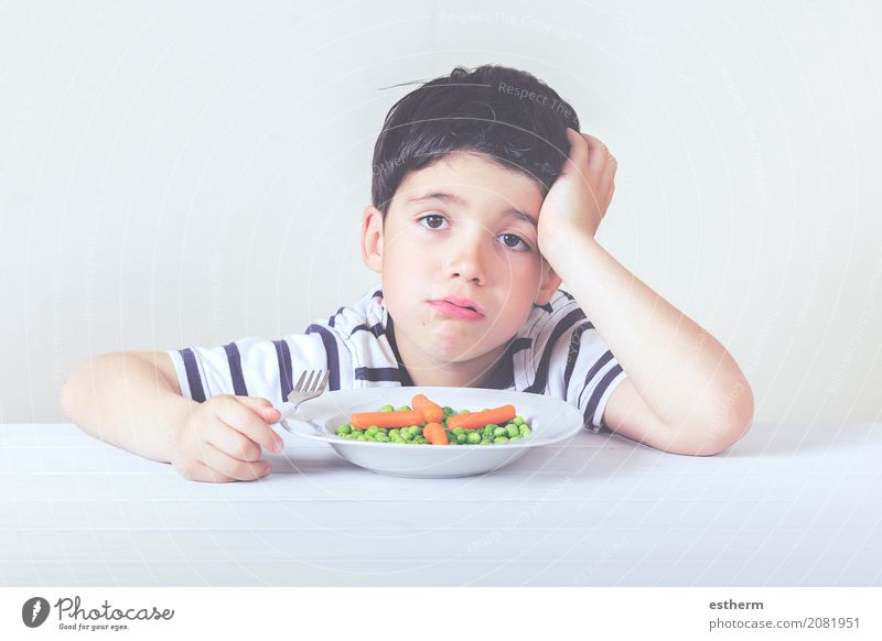 Sad child with a meal Food Vegetable Nutrition Eating Plate Fork Lifestyle Healthy Eating House (Residential Structure) Human being Masculine Child Toddler