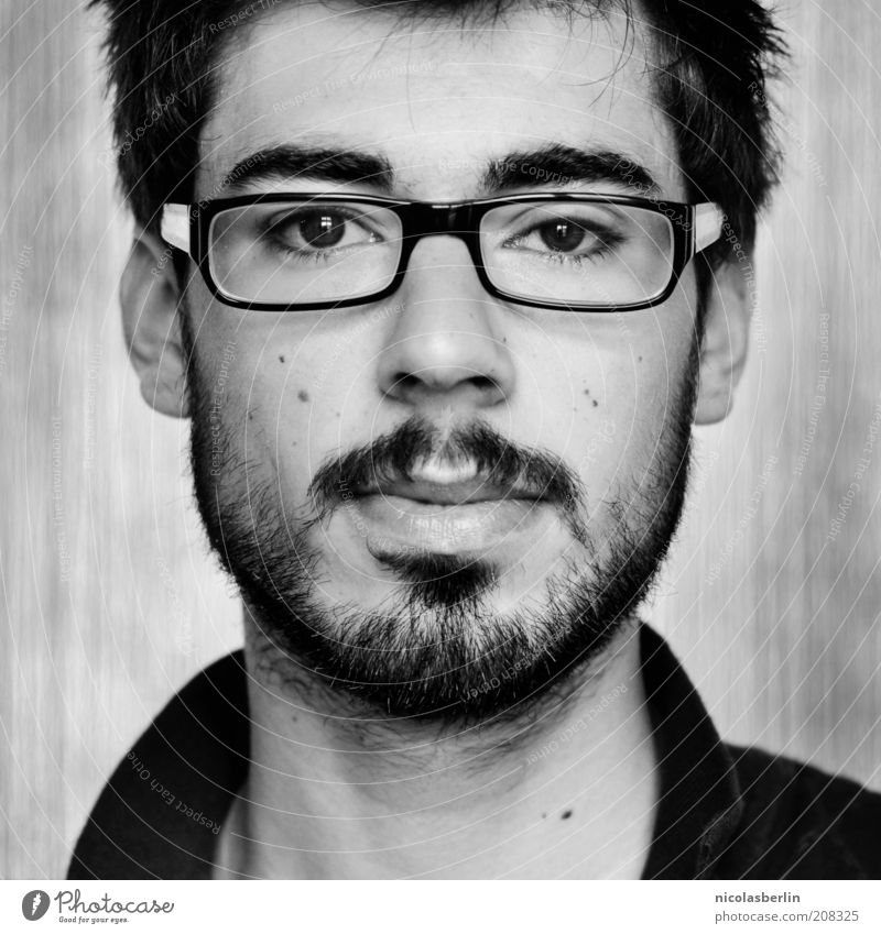Youth (Young adults) Beautiful Face Black Adults Think Wait Masculine Eyeglasses Observe Portrait photograph Facial hair 18 - 30 years Direct Hip & trendy