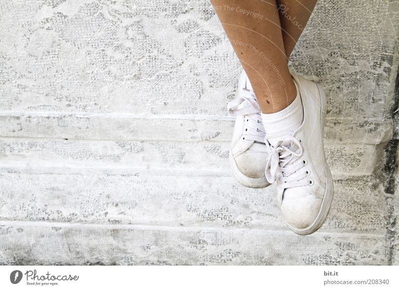Youth (Young adults) White Vacation & Travel Calm Relaxation Wall (building) Wall (barrier) Legs Fashion Bright Feet Contentment Footwear Dirty Facade Trip
