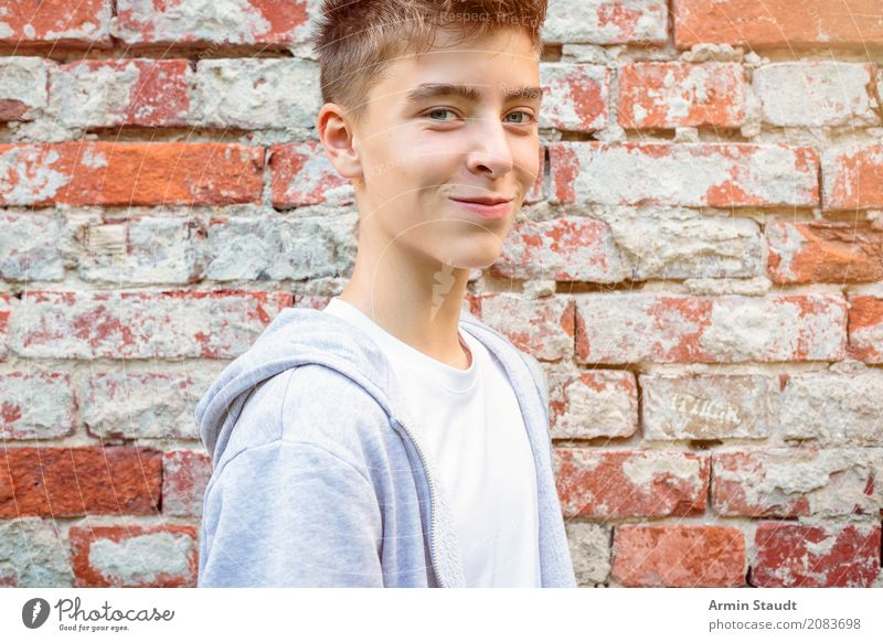 Portrait in front of brick wall Lifestyle Style Beautiful Contentment Senses Human being Masculine Young man Youth (Young adults) 1 13 - 18 years Wall (barrier)