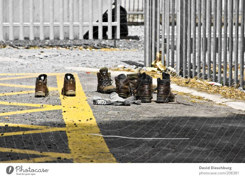 Day1 - Day14 = Dry shoes Summer Stockings Leather Footwear Boots Hiking boots Yellow Gray Laced boot Grating Fence Metal Parking lot In pairs Colour photo