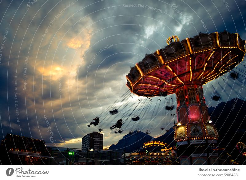 the orchestra plays to the end. Joy Fairs & Carnivals Chairoplane Carousel Trip Summer Event Clouds Storm clouds Sunlight Flying Illuminate Threat Dark