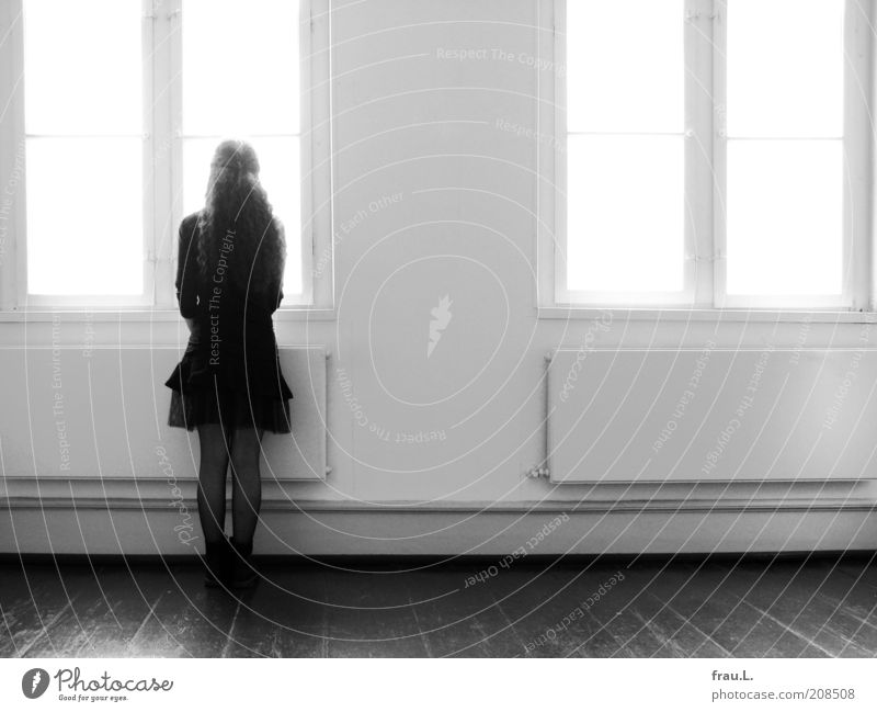 time windows Human being Young woman Youth (Young adults) 1 Window Skirt Boots Long-haired Observe Looking Stand Wait Expectation Time Black & white photo
