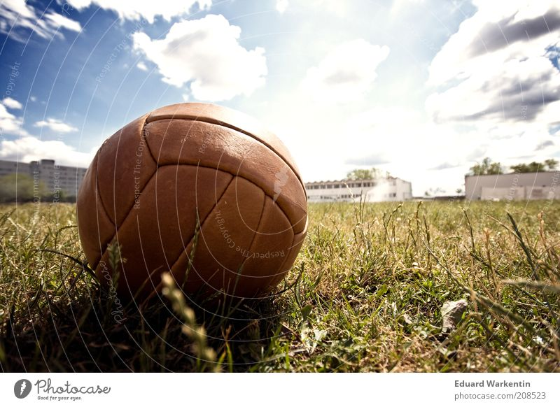 football summer Leisure and hobbies Ball sports Soccer Sporting Complex Football pitch Bright Foot ball Lawn Sky Clouds Beautiful weather Brown Leather Grass