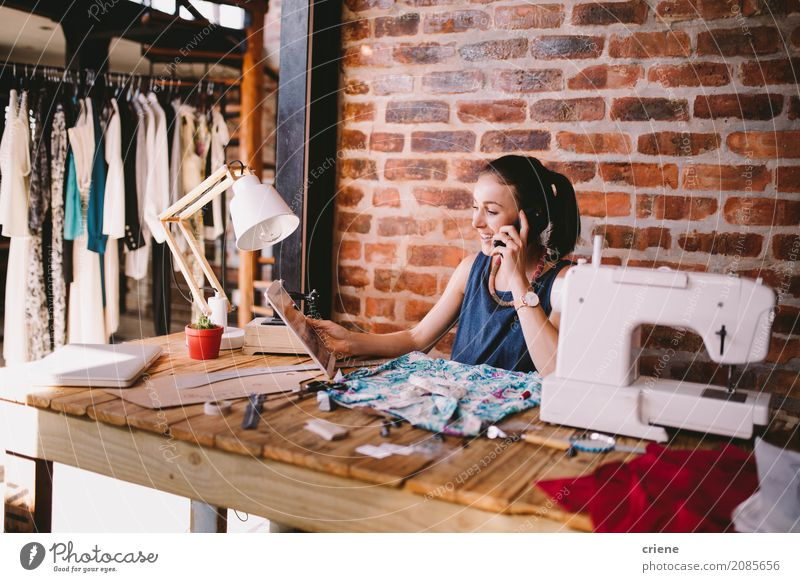 Young businesswoman speaking to customer on the phone Human being Woman Youth (Young adults) Young woman Joy Adults Lifestyle To talk Feminine Business Work and employment Office Modern Technology Sit Telecommunications