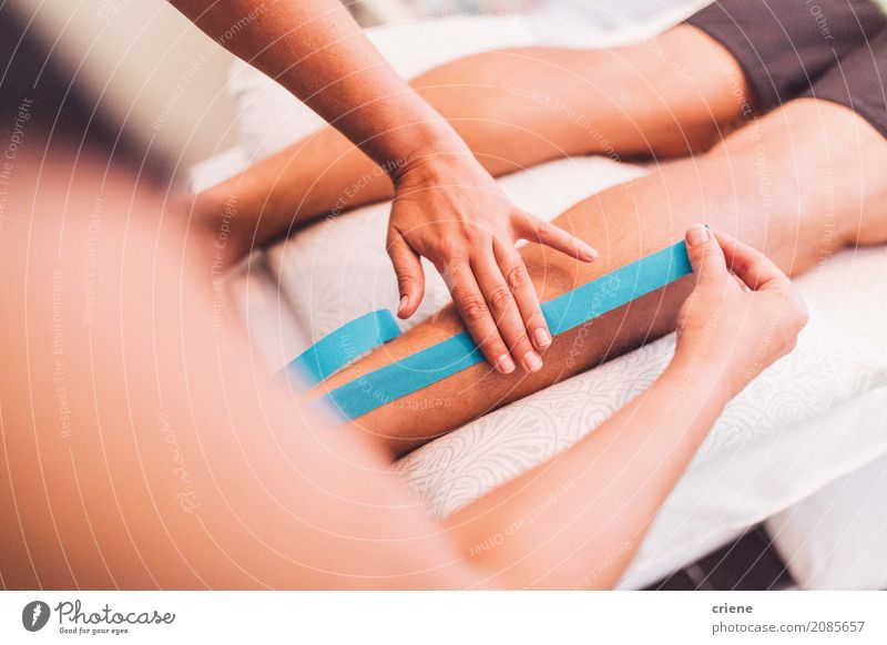 Doctor using tape on leg of patient Personal hygiene Body Healthy Health care Medical treatment Life Well-being Relaxation Hand Legs Lie Pain health Wound