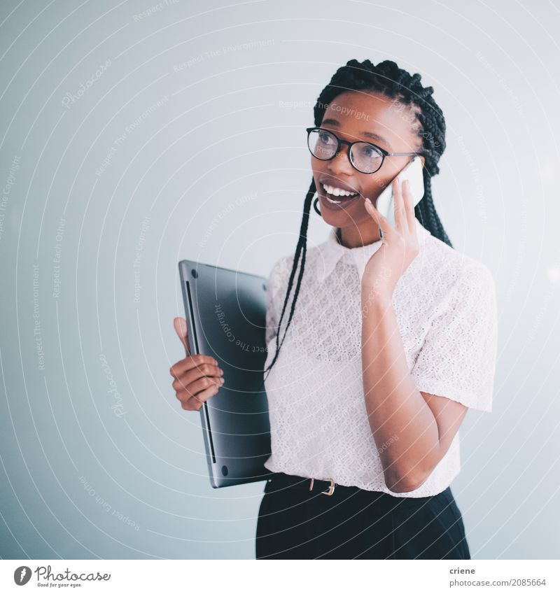 African businesswoman in a conversation on the phone Human being Youth (Young adults) Young woman Lifestyle To talk Feminine Business Work and employment Office Modern Technology Success PDA Speech To call someone (telephone) Leader