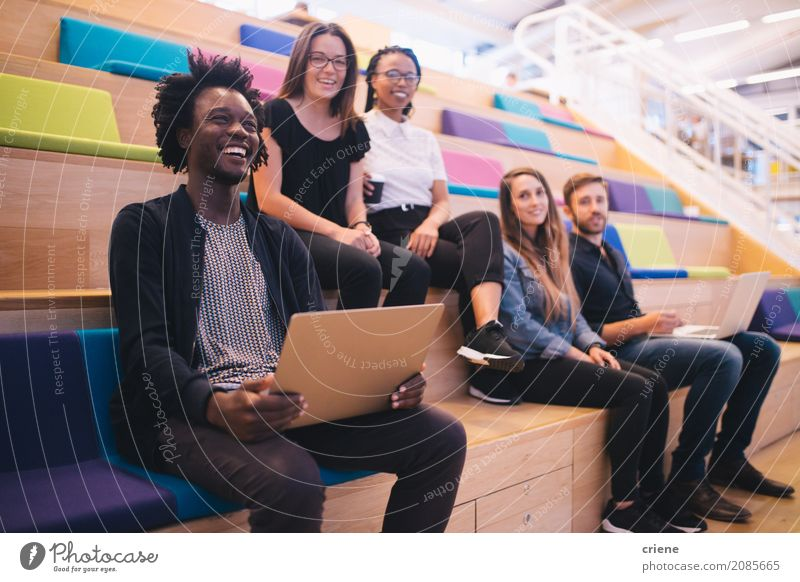 Group of mixed race team of employees in office Human being Youth (Young adults) Young woman Young man Lifestyle Happy Work and employment Office Modern