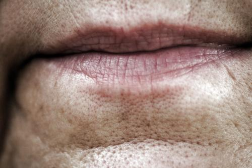 lip service Woman Adults Lips 1 Human being 45 - 60 years Old Natural Senior citizen Colour photo Close-up Detail Day Wrinkle Skin Pore Detail of face