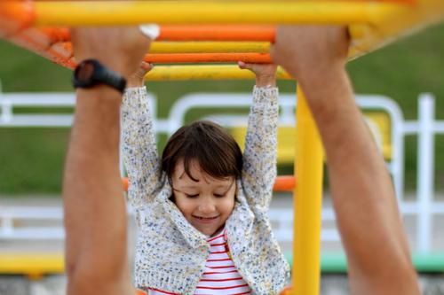 Little happy girl at the playground Playing Children's game Parenting Education Kindergarten Schoolyard Classroom Human being Baby Girl Parents Adults