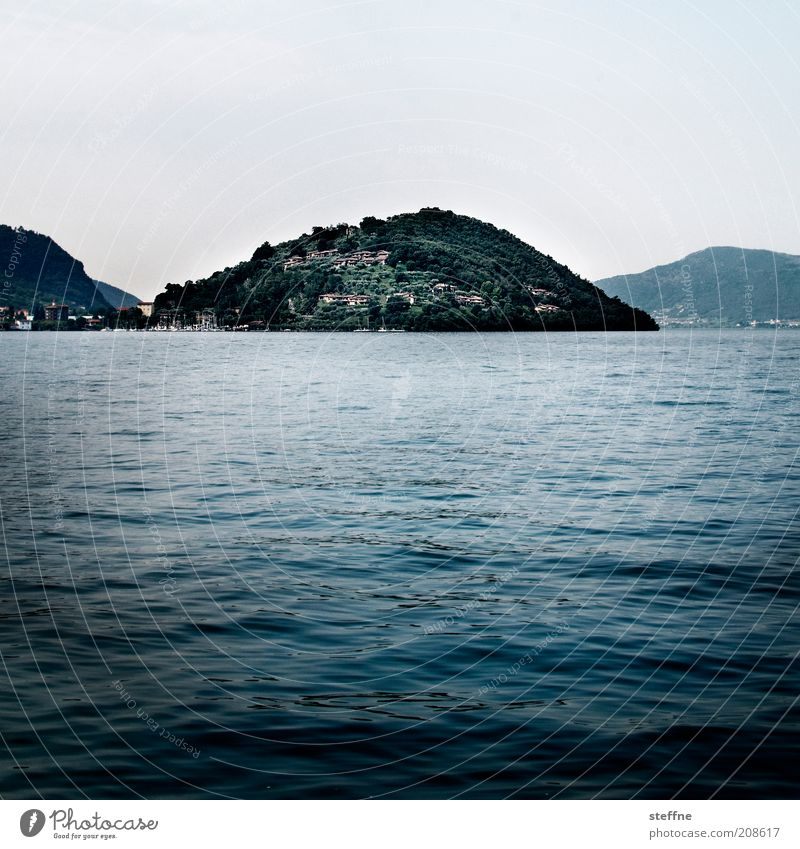 Even more mature for the island Nature Landscape Water Cloudless sky Waves Coast Lakeside Island Italy Esthetic Blue Lago d'Iseo Colour photo Subdued colour