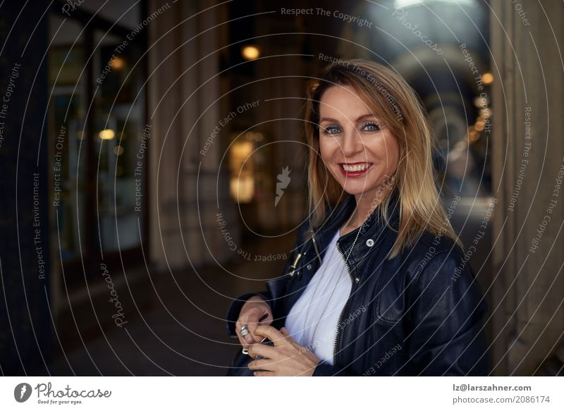Attractive trendy woman walking through an arcade Human being Woman Summer Adults Happy Copy Space Blonde Stand Smiling Mysterious Hip & trendy Jacket