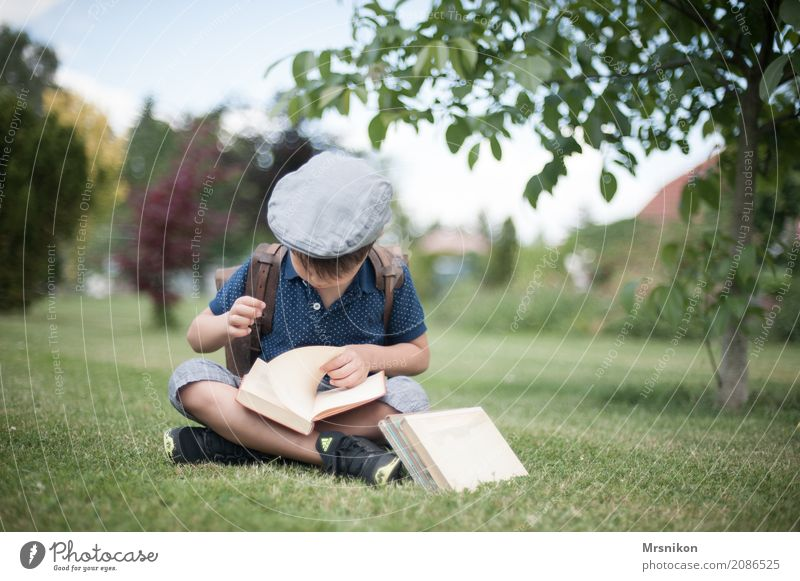 enrolment Child Boy (child) Infancy 1 Human being 3 - 8 years Discover Study Reading Sit First day at school Cap Satchel Book Garden Exterior shot School
