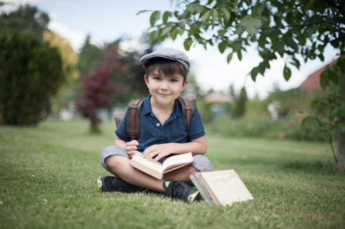 Human being Child Life Meadow Boy (child) Garden Infancy Sit Smiling Study Book Cap Ancient Summery 3 - 8 years First day at school
