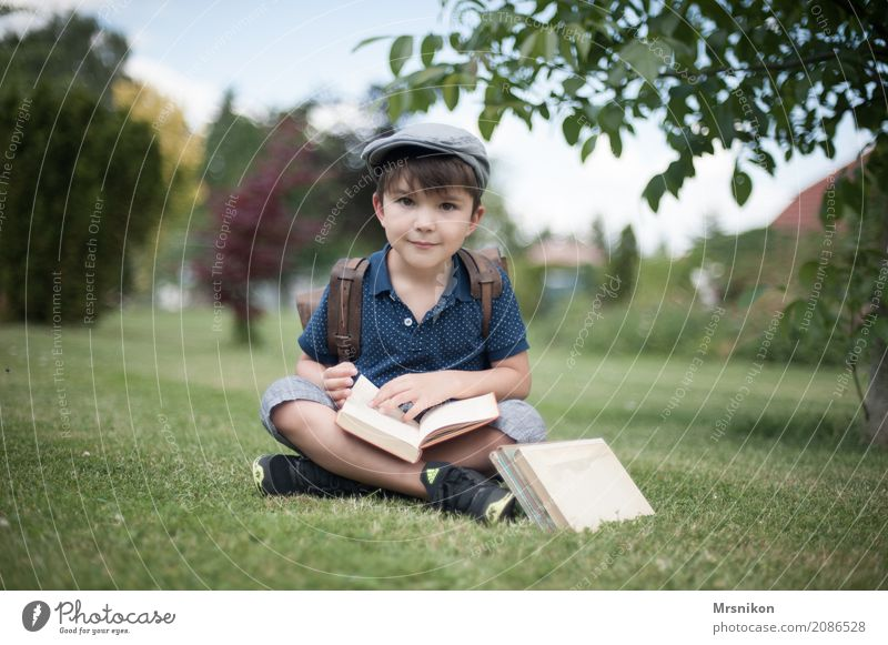 Human being Child Life Boy (child) School Infancy Sit Smiling Study Book Reading Brunette Ancient 3 - 8 years First day at school Satchel
