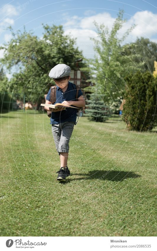 reading Masculine Child Toddler Boy (child) Infancy Life 1 Human being Sky Summer Beautiful weather Garden Park Meadow Hat Cap Beret Think Walking Study Smart