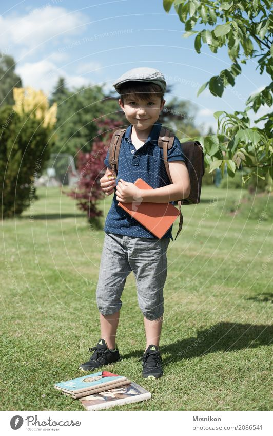I'm tall Parenting Education Child School Study Schoolchild Student Boy (child) Infancy Life 1 Human being 3 - 8 years Think Smiling Reading Looking Stand