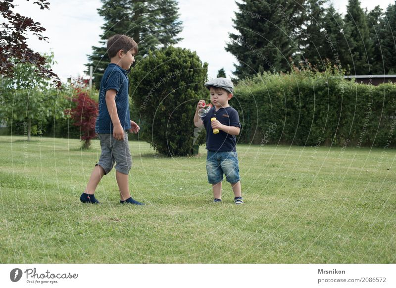 Human being Child Summer Meadow Boy (child) Laughter Playing Garden Infancy Smiling Walking Group of children Cap Toddler Blow Bubble