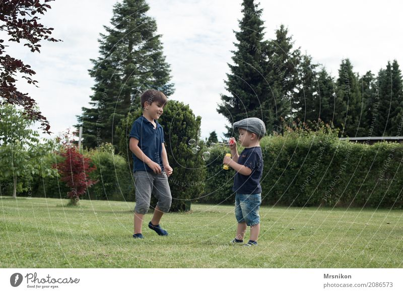 Human being Child Love Natural Boy (child) Laughter Playing Garden Together Leisure and hobbies Infancy Smiling Happiness To enjoy Observe Cute
