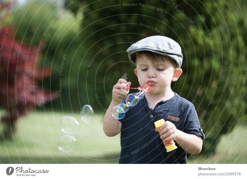 soap bubbles Child Toddler Young woman Youth (Young adults) Infancy Life 1 Human being 1 - 3 years Happiness Soap bubble Blow Children's game Happy Bubble