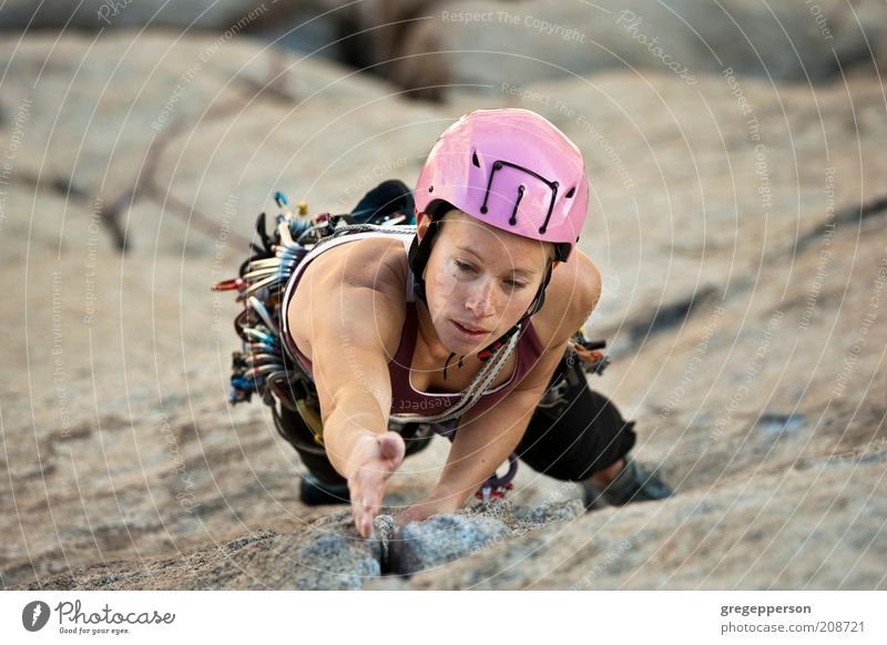 Female rock climber. Human being Youth (Young adults) Adults Life Sports Power Tall Adventure Rope 18 - 30 years Young woman Climbing Concentrate Risk Brave