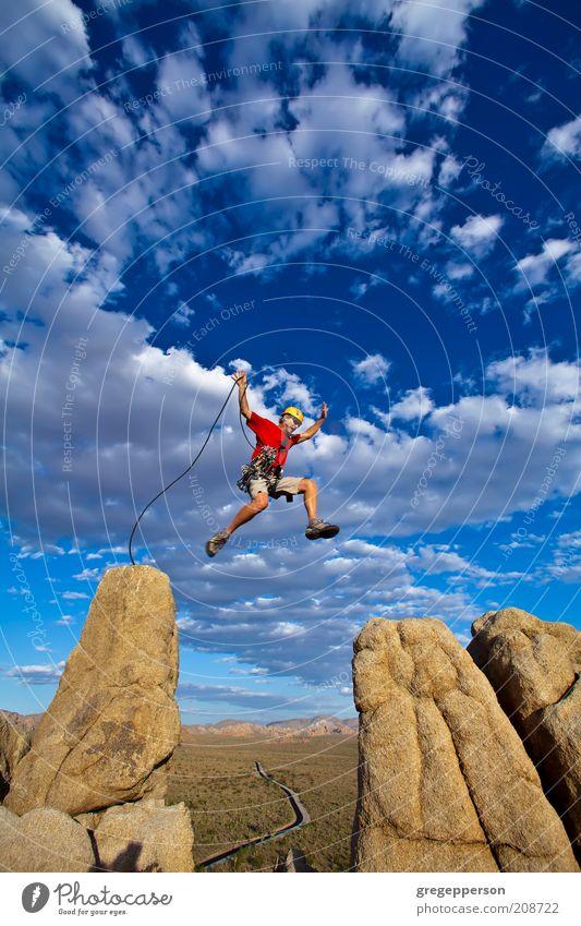 Climber jumping across gap. Human being Man Adults Life Mountain Jump Power Rock Flying Tall Adventure Dangerous Rope Success Climbing Peak