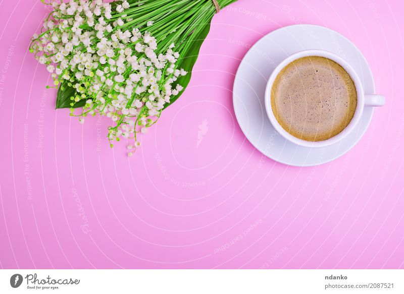 Cup of coffee Breakfast To have a coffee Beverage Coffee Mug Table Flower Bouquet Hot Above Green Pink White drink Lily of the valley Top cup Saucer Fragrant