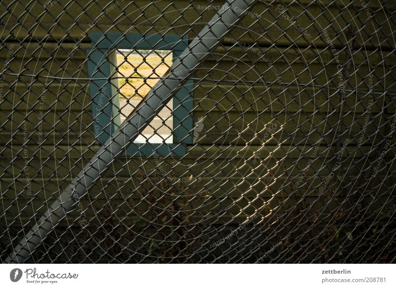 PC - the unknown addiction Summer Old Fence Wire netting fence Border Hollow Window Hatch Vista Safety Divide Passage Sunlight Shaft of light Colour photo