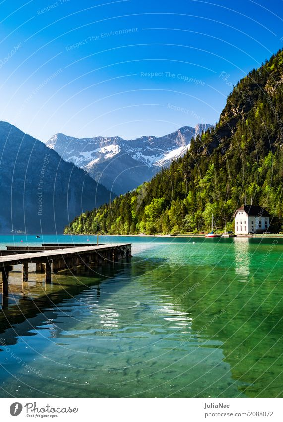 Lake with jetty and mountains in the background Relaxation Calm Vacation & Travel Snow Mountain Nature Landscape Water Sky Cloudless sky Spring
