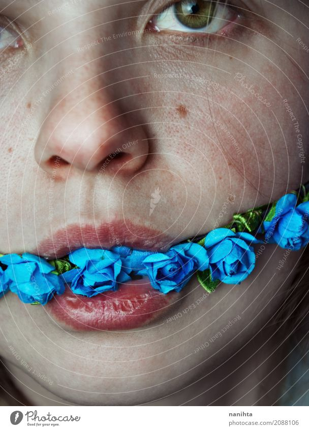 Artistic portrait of a young woman with flowers in her mouth Lifestyle Skin Face Eyes Lips Human being Feminine Young woman Youth (Young adults) 1 18 - 30 years