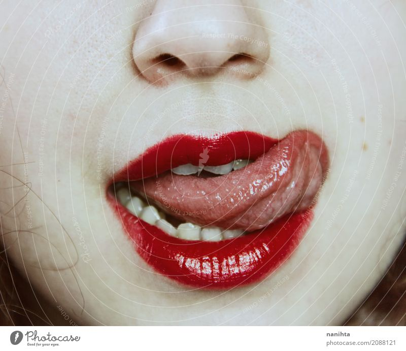 Close up of a young woman's mouth sticking out her tongue Skin Face Lipstick Human being Feminine Young woman Youth (Young adults) Nose Mouth Tongue 1