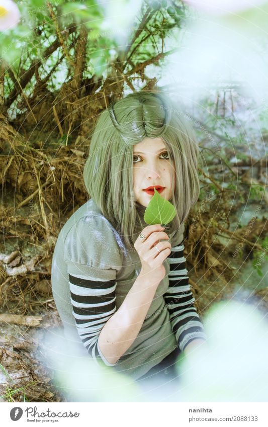 Young woman with a leaf in her hands Human being Nature Youth (Young adults) Summer Beautiful Green White Leaf Calm Forest 18 - 30 years Adults Environment