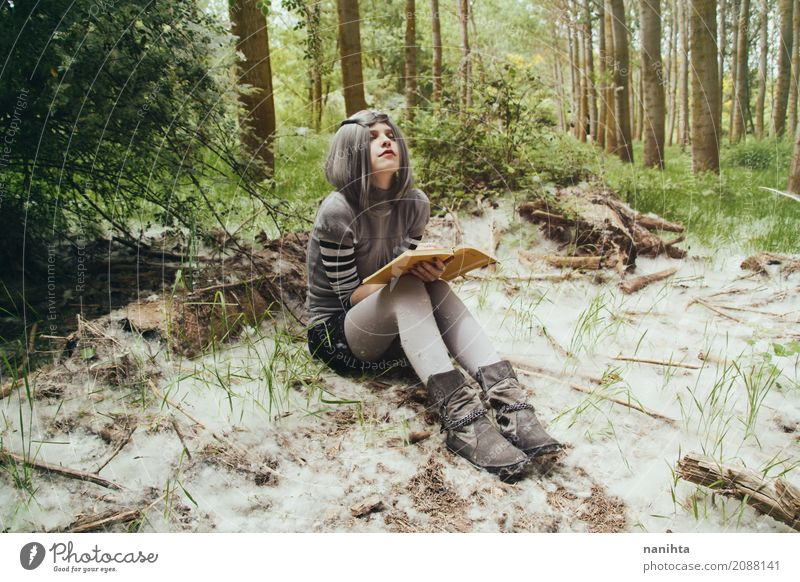 Young woman with a book in a forest Lifestyle Relaxation Reading Human being Feminine Youth (Young adults) 1 18 - 30 years Adults Environment Nature Landscape