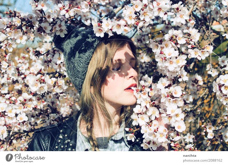 Young woman posing with a lot of almond flowers Human being Nature Youth (Young adults) Plant Beautiful Tree Flower Relaxation Calm 18 - 30 years Adults