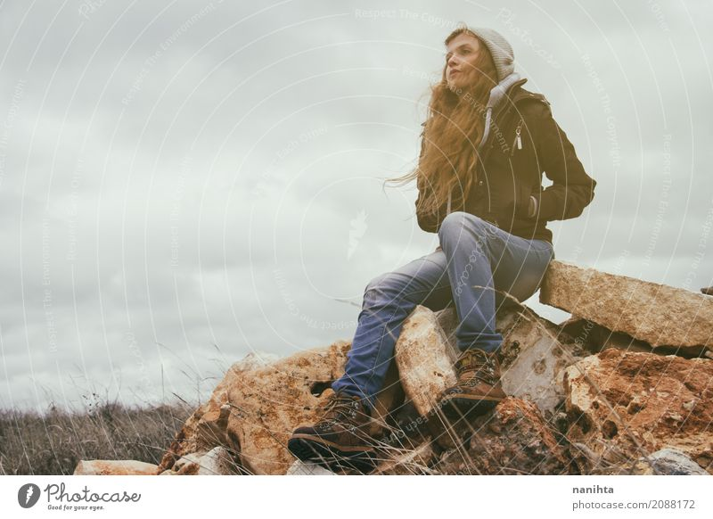 Young blonde woman in a stormy day Human being Nature Youth (Young adults) Young woman Loneliness Calm Mountain Environment Life Lifestyle Autumn Feminine