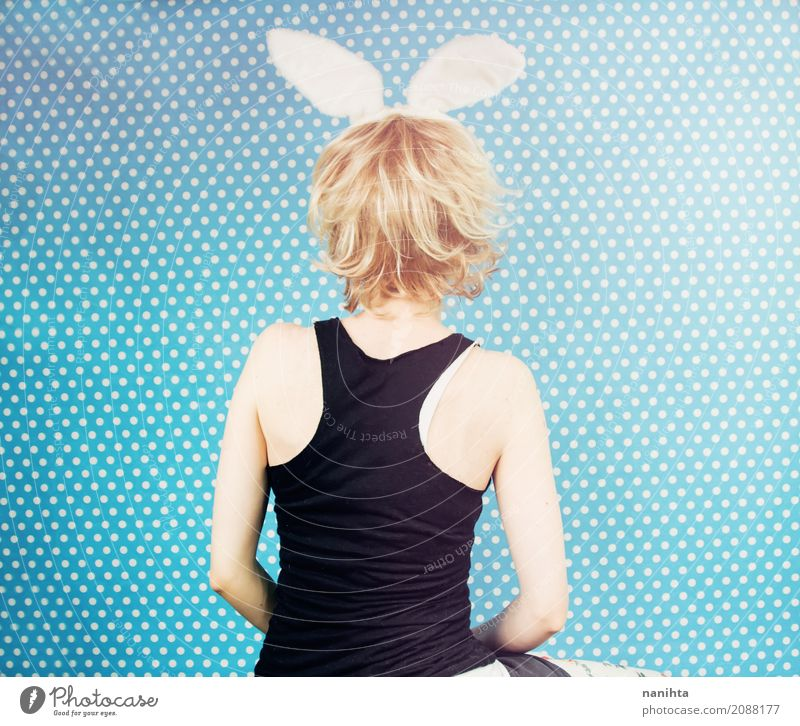 Back view of a young woman wearing rabbit ears Human being Youth (Young adults) Blue Young woman White Joy 18 - 30 years Black Adults Funny Feminine