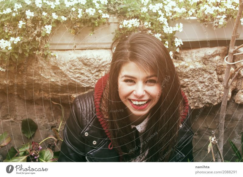 Young and happy woman smiling Human being Youth (Young adults) Young woman Beautiful Flower Joy 18 - 30 years Adults Life Lifestyle Feminine Style Laughter