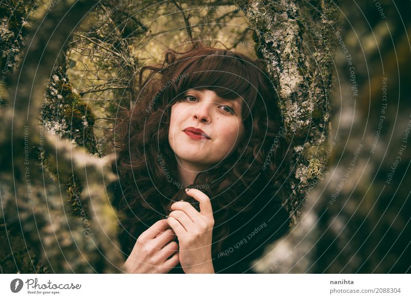 Portrait of a young brunette woman into the woods Human being Nature Youth (Young adults) Young woman Beautiful Green Tree Calm Forest 18 - 30 years Adults
